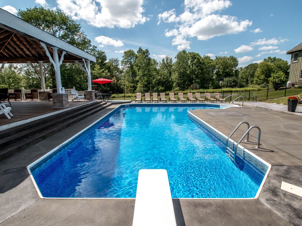 crystal clear pool with plenty of lounge chairs heated water optional