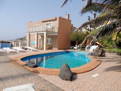 Photo for In front of the sea with pool and Jacuzzi with sea water, both
