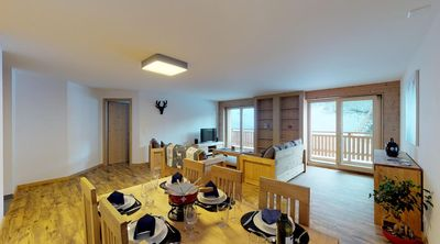 Photo for 4*, 2-bedroom-apartment, for 4-6 people right on the ski slopes. Modern and spacious living room wit