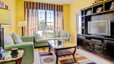 Photo for Vibrant Condo in Private Resort near Disney - 3 Bedrooms, 2 Bathrooms