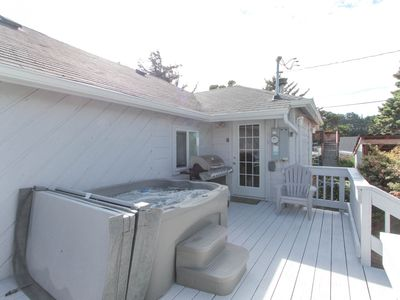 Photo for NEW LISTING! Private, dog-friendly home w/ hot tub - walk to the beach
