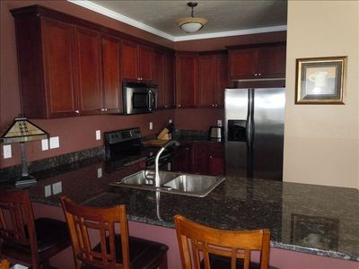 Kitchen with stainless appliances and granite countertop