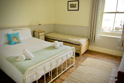 Bedroom 1. Double bed with built in wardrobe and fantastic views of the harbour.