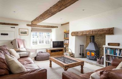 Photo for Holly Cottage is a beautifully presented Cotswold stone cottage, in the village of Coln St Aldwyns