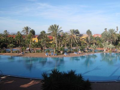 Photo for Apartment with sea views in Corralejo, palm garden, terrace and 3 pools.