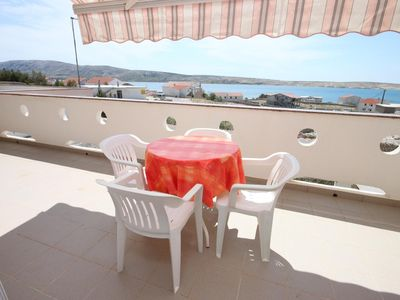 Photo for One bedroom apartment with terrace and sea view Kustići (Pag) (A-6287-a)