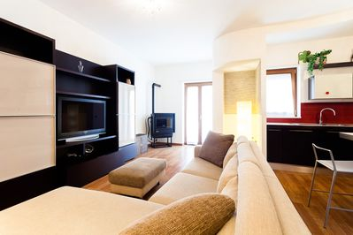 Living room with couch, TV, pellet stove, balcony, fully equipped kitchen, WiFi