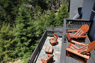 Two decks overlook forest with view of ocean