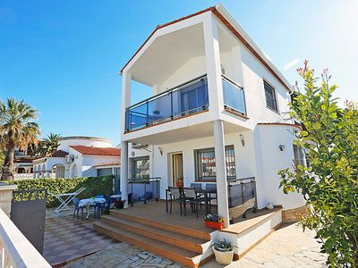 Photo for 4 bedroom Villa, sleeps 9 with Air Con and Walk to Beach & Shops