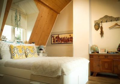Loft-style bedroom sanctuary with rooftop windows and plenty of wardrobe space.