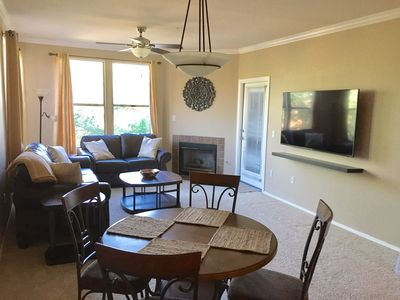 """Family room with all new furniture and new 65"""" Samsung Ultra HD Smart TV"""