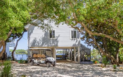 Photo for A Hasty Retreat  -  3 bed 2 bath home with private dock 2 seater golf cart !