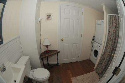 First floor bathroom with shower and washer/dryer.
