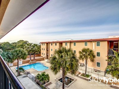 Photo for Luxury Gated Condo with Community Pool & Just Steps to the Beach