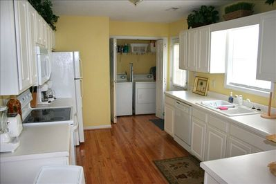 View of laundry room from spacious kitchen