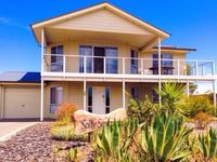 Fantastic, well-appointed home, quiet street and just minutes from the beach.