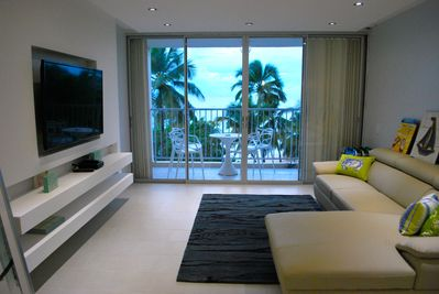 Living room and balcony, steps from beach