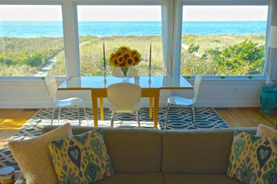 dining room picture windows framing the Sound and path to the beach