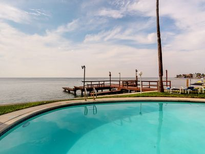 Photo for Bayfront condo w/ shared pool & private boat slip - close to beach!