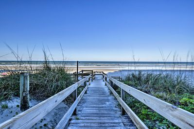The vacation rental condo is part of Moontide Condominiums located on the beach!