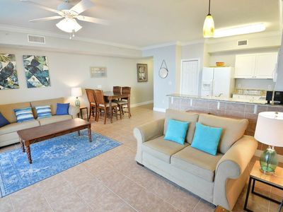 Photo for Elegant gulf-front condo w/ 2 lagoon pools, hot tubs, movie theater & more!