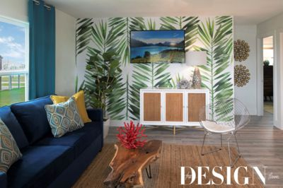 A palm-frond focal wall and modern furnishings.