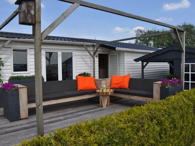 Photo for Chalet directly on the beach of Terherne with unique view of the Sneekermeer