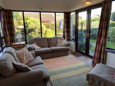 Photo for Delightful cosy home, a short walk from beach promenade cafes and mountains.