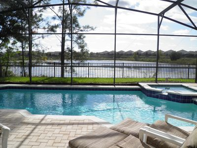 Photo for Fabulous Lake View/South Facing Pool Home | Game room | 2 Miles to Disney!