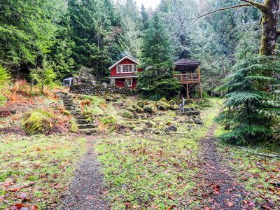 Photo for Secluded, waterfront lodge on 24 wooded acres w/ furnished patio & fireplace