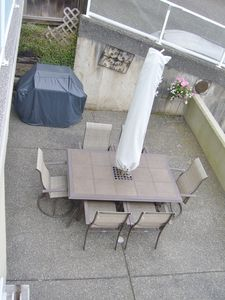 Alfresco dining is easy with a well equipped kitchen and a Weber propane grill.
