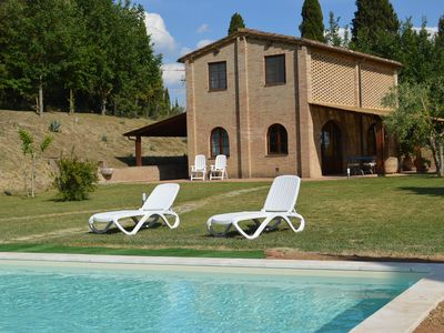 Photo for Panoramic views of the hills of Siena from home and private pool
