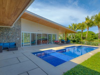Photo for Modern Family Home w/pool, steps to beach in private community