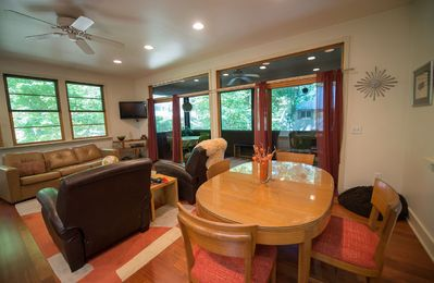 Living room with screened porch in background