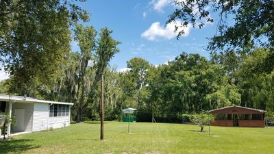 Photo for Fishermans Dream !!!  2 bedroom, 2 bathroom home, on canal with boathouse.