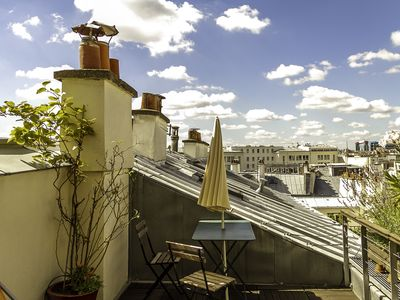 Photo for Charming terrace with stunning views!