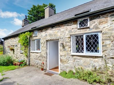 Photo for A charming 13th Century former mill cottage in the pretty rural village of Llanigan, just 1.5 miles