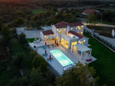 Photo for Design Villa Sole ***** with 48m² heated pool, game room, fitness & spa house