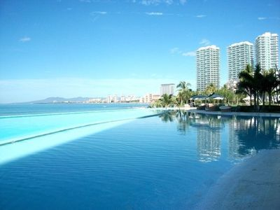 Peninsula-a luxurious oceanfront complex, our infinity pool rolls into the ocean
