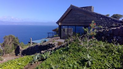 Photo for Casa da Canada - A romantic stone house, overlooking the sea and the infinity pool.