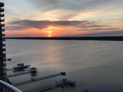 Watch the sun melt into the bay every night from our 2 paitos.