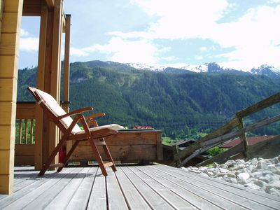 Summer relaxation on the veranda  gazing at stunning mountain scenery....
