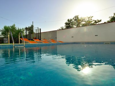 Photo for Lovely apartment for 7 guests with WIFI, private pool, A/C, TV and parking