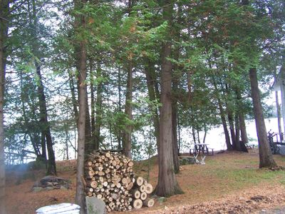 Get the hot dogs ready! The firewood awaits!.  Campfire to left, Picnic table and cottage deck on right.