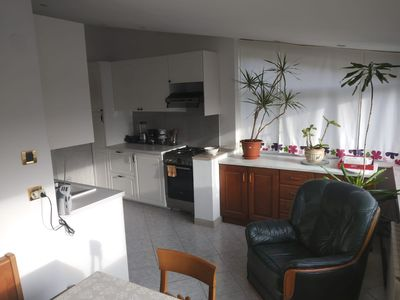 New kitchen and spacious dining area.  It also has a dishwasher.