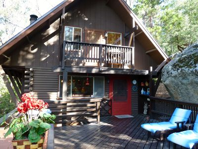 Large deck with BBQ, table & chairs, umbrellas, lounge chairs.