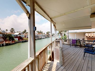 Photo for Charming canal-front home w/ dock & shared pools/hot tub/tennis - 2 dogs OK