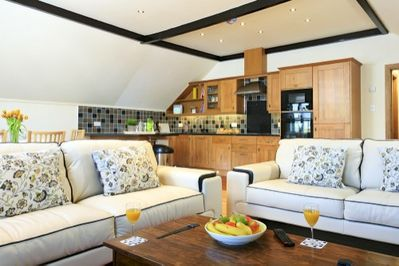 Open Plan living area with two 3 seater Sofas