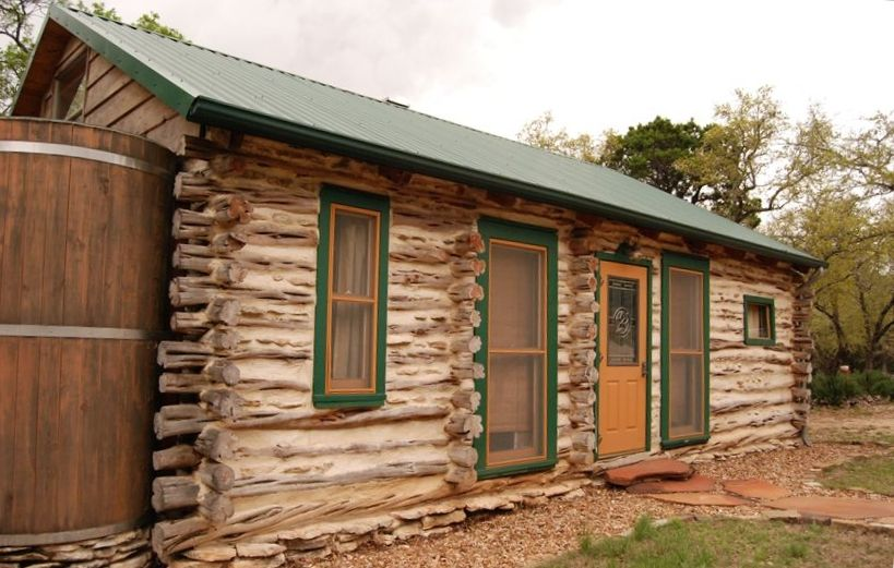 Cedar cabin retreat log cabin with private hot tub canyon for Texas hill country cabin builders