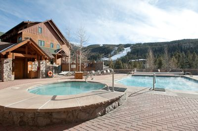 Take a dip in the outdoor hot tub and enjoy mountain views.